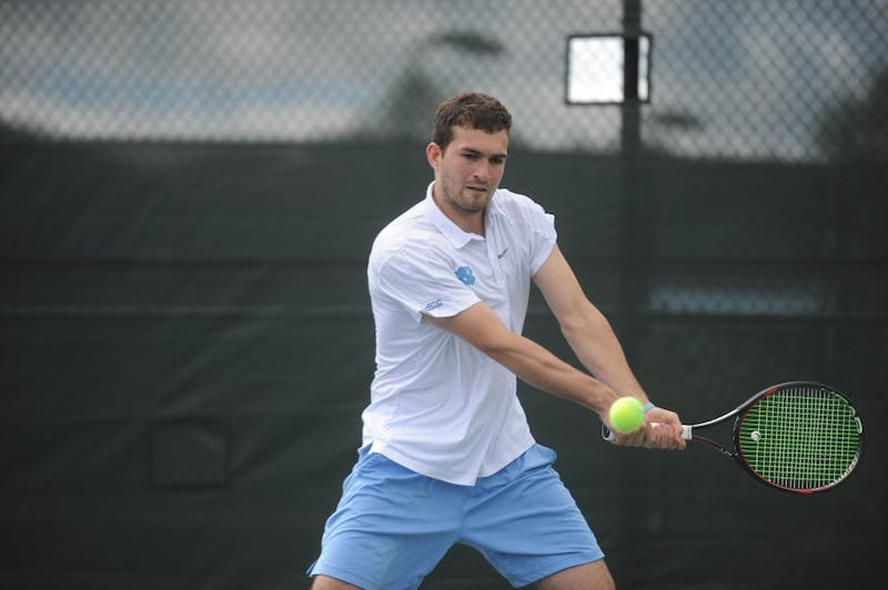 Junior William Blumberg backhands the tennis ball at the ACC tournament semifinals. UNC played against Virginia and lost 3-4. Blumberg won his doubles match with senior Blaine Boyden and lost his singles match.