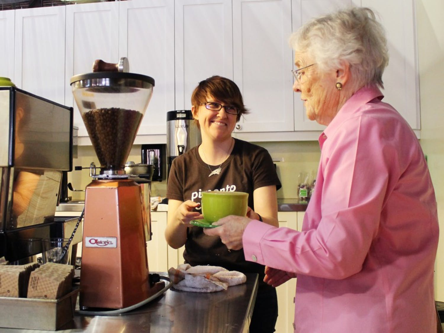 """At Parker and Otis, a local store in Durham, Emily Hester of Raleigh serves Margaret Keller of Durham. Keller visits Parker and Otis as often as she can because, """"This is one of the two best places in Durham with the best cappuccinos, and I prefer local places."""""""