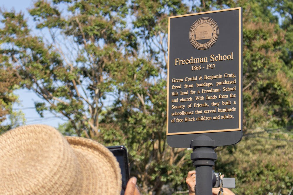 A plaque honoring the Freedman School was unveiled outside of St. Paul A.M.E. Church in Carrboro on Monday, August 9.