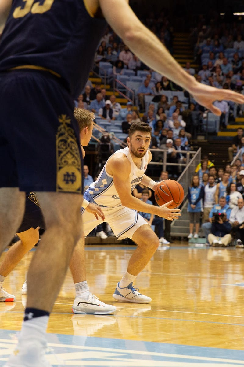 UNC junior guard Andrew Platek (3) runs down court on Wednesday, Nov. 6, 2019 at the Smith Center. UNC beat Notre Dame 76-65.