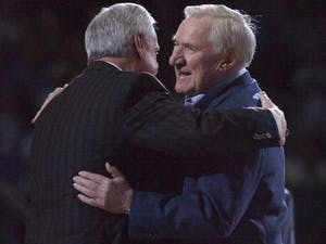 University of North Carolina coach Roy Williams, left, embraces former coach Dean Smith during the Celebration of a Century at the Smith Center in Chapel Hill, North Carolina, Friday, February 12, 2010. This is the 100th year of Carolina basketball. (Robert Willett/Raleigh News & Observer/MCT)