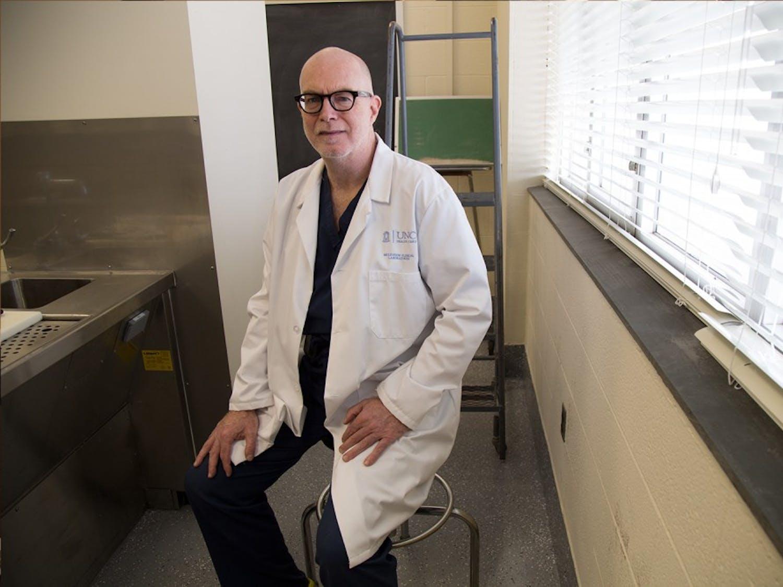 Medical Examiner and Assistant Professor Vincent Moylan sits in the presentation room in Brinhous-Bullitt Building on Sunday.