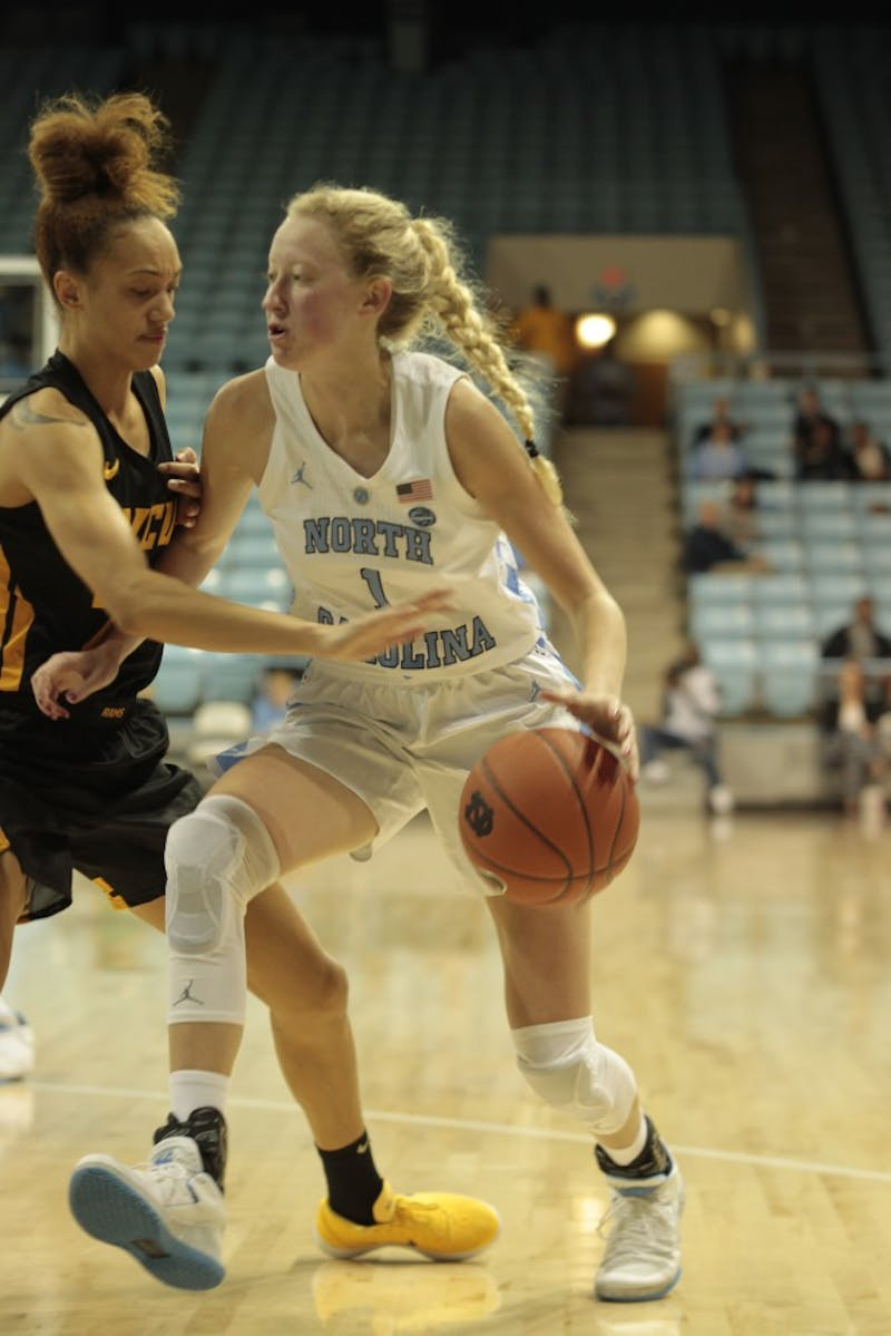 Junior guard Taylor Koenen (1) dribbles past a defender during Wednesday's game against Virginia Commonwealth University at Carmichael Arena. UNC won 59-47.