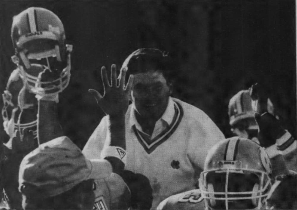 <p>Mack Brown celebrates after his first win as head coach of the North Carolina football team. The Tar Heels defeated Georgia Tech, 20-17, on Oct. 22, 1988, in Kenan Stadium to move to 1-6. DTH File Photo/David Surowiecki</p>