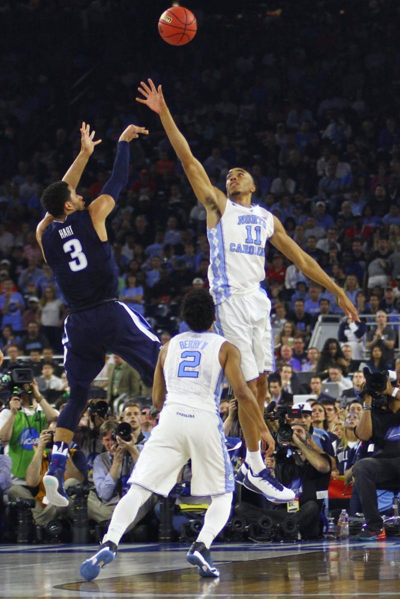 Brice Johnson (11) goes up to block a shot from Josh Hart (3).