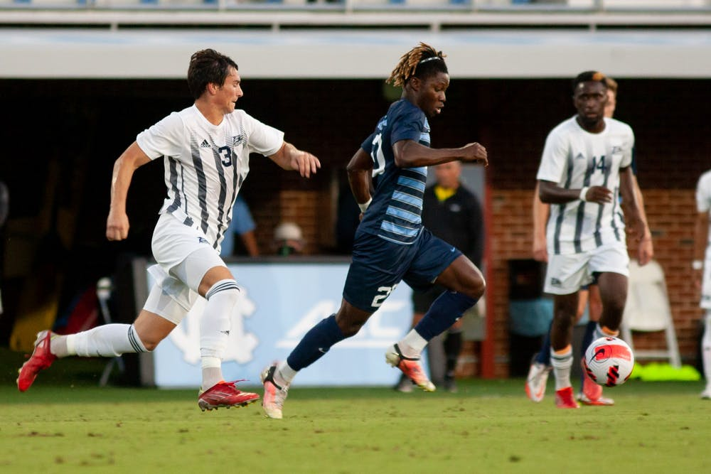 UNC sophomore midfielder/forward Ernest Bawa (20) chases after the ball at the UNC v. Georgia Southern game at Dorrance Field on Sept. 3.