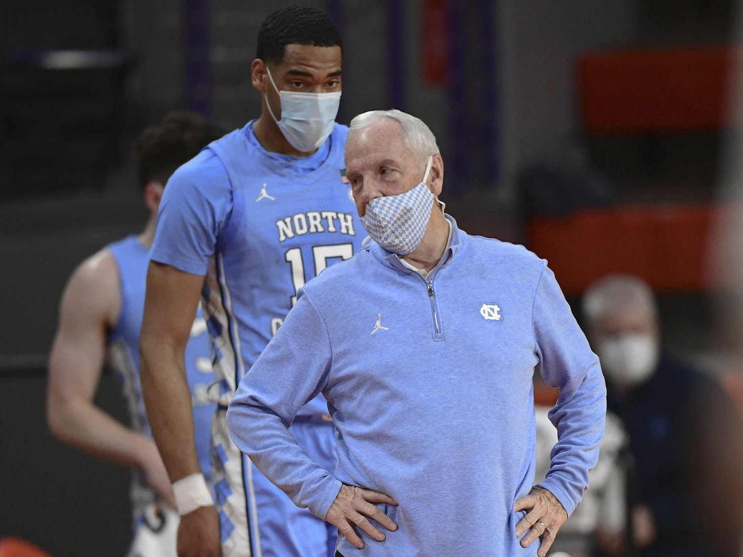 Head coach Roy Williams and senior forward Garrison Brooks (15) stand on the sideline during UNC's 63-50 loss at Clemson, Feb 2 2021. Photo courtesy of Ken Ruinard.
