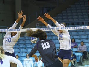 Sydnye Fields (10) and Julia Scoles (12) go up for a block.