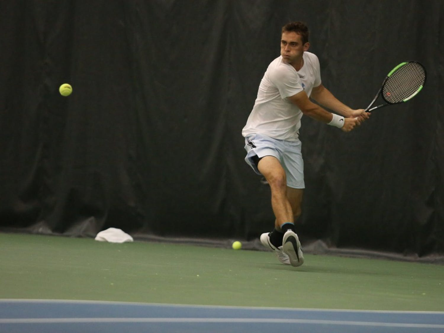 UNC men's tennis sophomore Benjamin Sigouin returns the ball against Boston College's Derek Austin during a singles match on Friday April 5, 2019. UNC defeated Boston College 5-1.