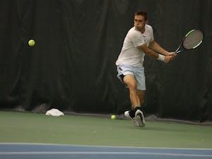 UNC men's tennis sophomore Benjamin Sigouin returns the ball against Boston College's Derek Austin during a singles match on Friday April 5, 2019. UNC defeated Boston College 5-1.