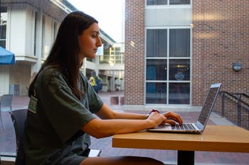 Kendall Harrow, a sophomore economics major, works on an assignment on her computer at the UNC Student Store on Wednesday, Oct. 9th, 2019.