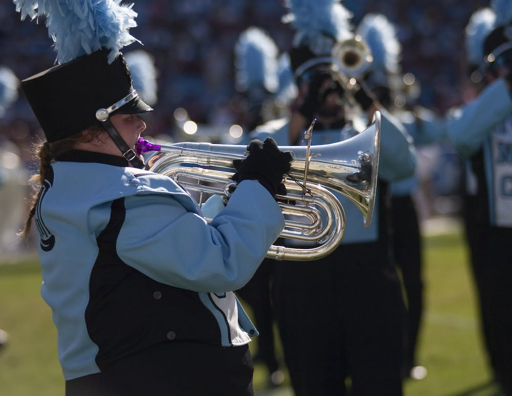 <p>Senior Annabelle Webb performs during halftime with The Marching Tar Heels during the Belk College Kickoff on Aug. 31, 2019. Due to the COVID-19 pandemic, the marching band is practicing remotely.&nbsp;</p>