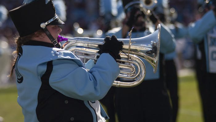 Senior Annabelle Webb performs during halftime with The Marching Tar Heels during the Belk College Kickoff on Aug. 31, 2019. Due to the COVID-19 pandemic, the marching band is practicing remotely.