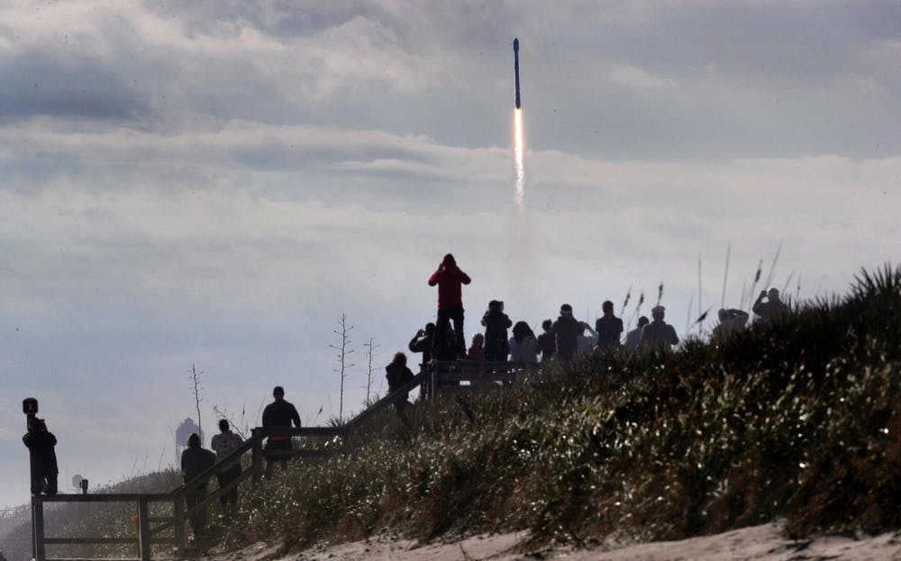 From Playalinda Beach at Canaveral National Seashore, visitors watch a SpaceX Falcon 9 rocket launch from Cape Canaveral Air Force Station. Photo courtesy of Joe Burbank/Orlando Sentinel/TNS
