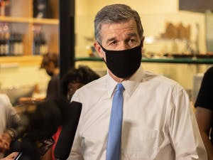 Gov. Roy Cooper speaks Thursday at Pizzeria Mercato in Carrboro, which recently implemented a vaccination requirement to dine there.