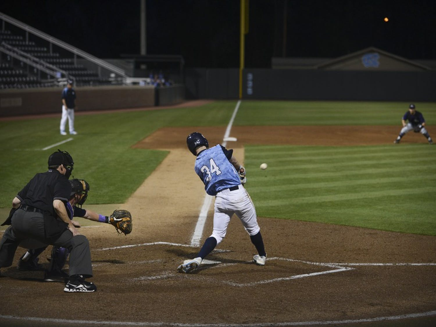 UNC freshman Brian Miller (34) rips a solid line drive to left field in Tuesday's game against High Point.
