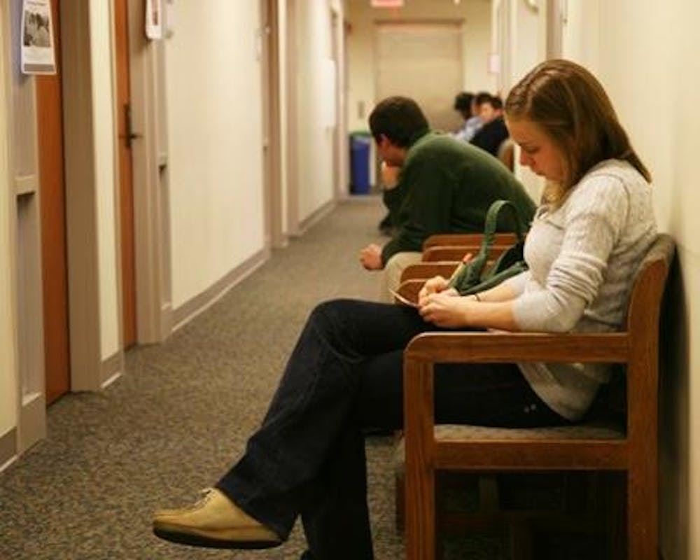 Catherine Cameron waits with other students for academic advising services in Steele Building.