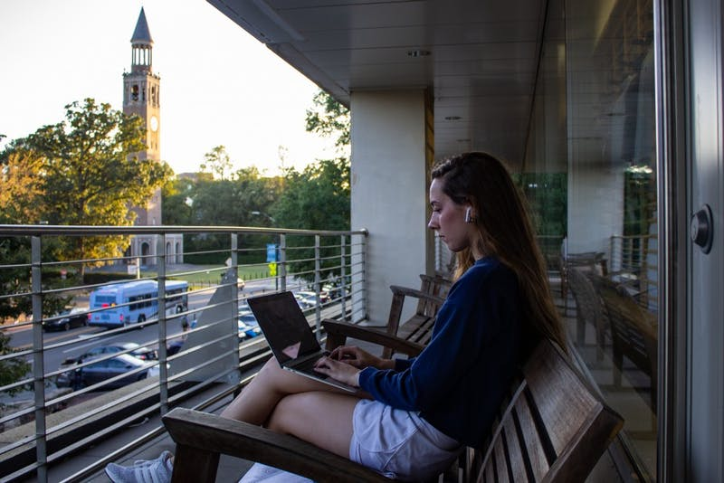 Emily Saunders, a first-year biology major, works on an assignment on her computer outside UNC Student Stores on Wednesday, Oct. 9, 2019.