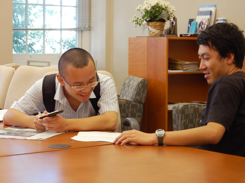 Zhe Wang (left) and Yadong Goo, both sophomores from China, review each other's resumes while waiting for a University Career Services counselor to call them into their meeting during the Resume Marathon.