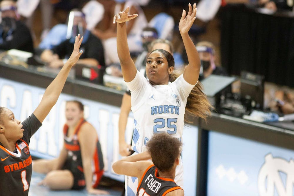 UNC first year guard Deja Kelly (25) makes a shot during a game against Syracuse in Carmichael Arena on Thursday, Dec. 17, 2020. UNC beat Syracuse in an upset 92-68.