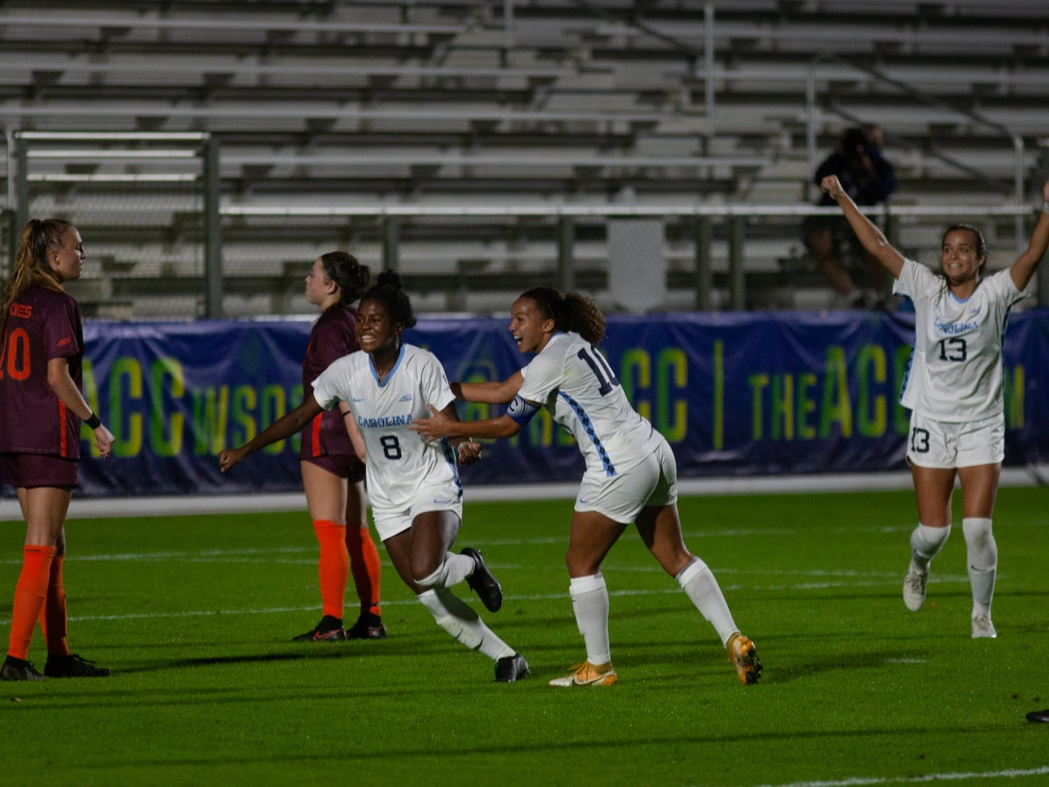 Members of the UNC women's soccer team celebrate a goal made by junior midfielder Brianna Pinto (8). The Tar Heels beat the Hokies 1-0 in the first round of the ACC tournament on Tuesday, Nov. 10 2020 at the WakeMed Soccer Park.