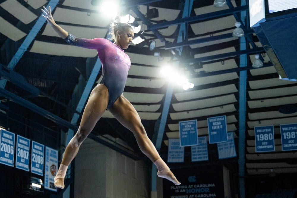 Senior Khazia Hislop performs her bar routine during the gymnastics meet against the University of New Hampshire in Carmichael Arena on Monday, Feb. 17, 2020. The Tar Heels placed first against the Wildcats.