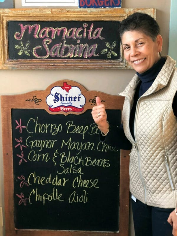 Photo courtesy of Sabrina Garcia. This photo shows Garcia at Al's Burger Shack, after the restaurant named a burger after she announced her retirement.
