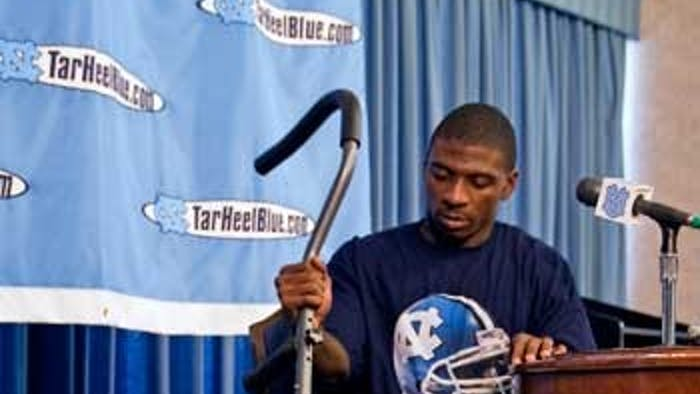 """Brandon Tate leaves the press conference at which he announced that he will miss the rest of the season.A senior"""" Tate holds the all-time NCAA record for kick return yards.Tate tallied 3523 yards with the Tar Heels."""