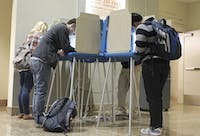 Students vote during the 2012 election at the Center for Dramatic Arts. Students must register today to vote in the primaries.