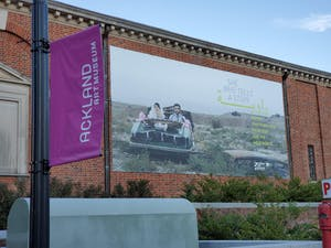 """Front of the Ackland Art Museum depicting the """"She Who Tells a Story"""" exhibit. The exhibit is in conjunction with the Ackland Film Forum at the Varsity Theater."""