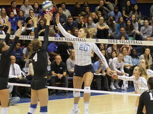 First Year Ava Bell (20) tips the ball during the game against Duke on Saturday, Nov. 17 at Cameron Stadium. UNC won 3 to 2.