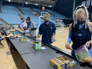 UNC women's basketball players make snack bags for TABLE. Photo courtesy of UNC Women's Basketball.