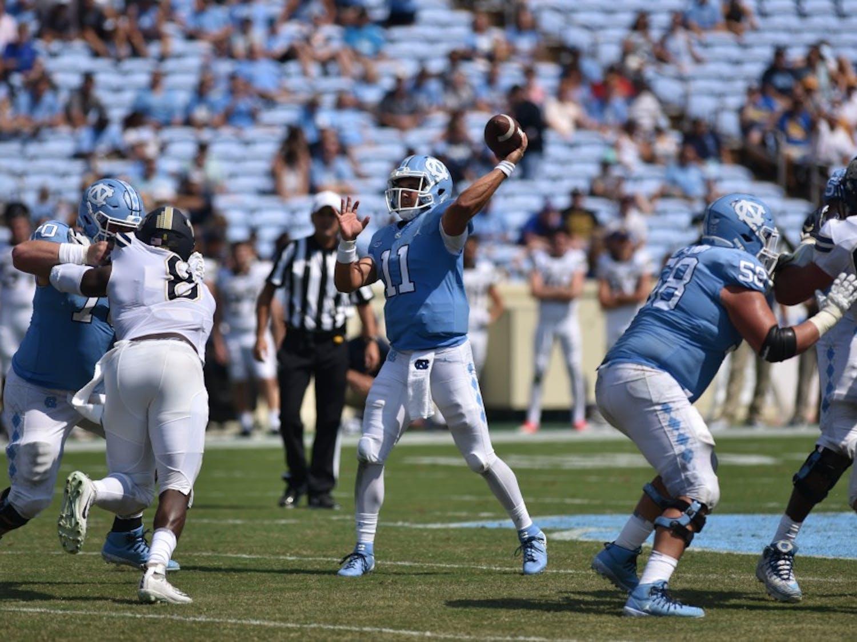 Junior quarterback Nathan Elliott (11) throws the ball against Pittsburgh on Saturday, Sept. 22. UNC defeated Pittsburgh 38-35 at Kenan Memorial Stadium.