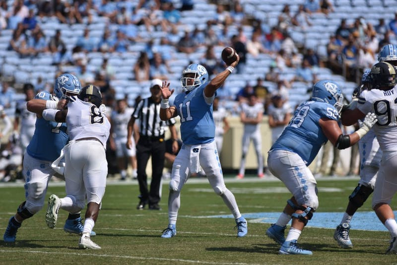Junior quarterback Nathan Elliott (11) throws the ball against Pittsburgh on Saturday, Sept. 22. UNC defeated Pittsburgh 38-35 at Kenan Memorial Stadium.
