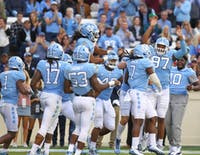 Linebacker Jonathan Smith (7) celebrates with his teammates after a fumble recovery touchdown against Western Carolina on Saturday in Kenan Stadium.