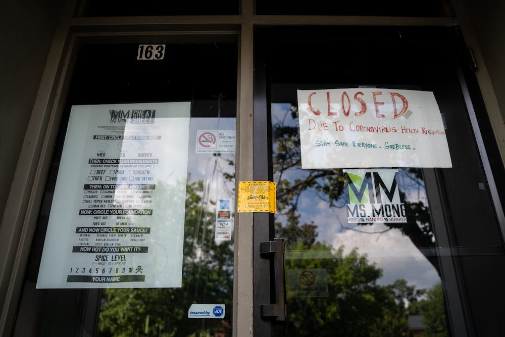 """Ms. Mong restaurant's front door and """"Closed"""" sign on Thursday, Aug. 20, 2020. Ms. Mong is one of the multiple businesses on Franklin Street that have closed due to health concerns surrounding the COVID-19 pandemic."""