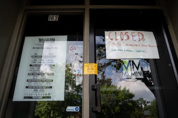 "Ms. Mong restaurant's front door and ""Closed"" sign on Thursday, Aug. 20, 2020. Ms. Mong is one of the multiple businesses on Franklin Street that have closed due to health concerns surrounding the COVID-19 pandemic."