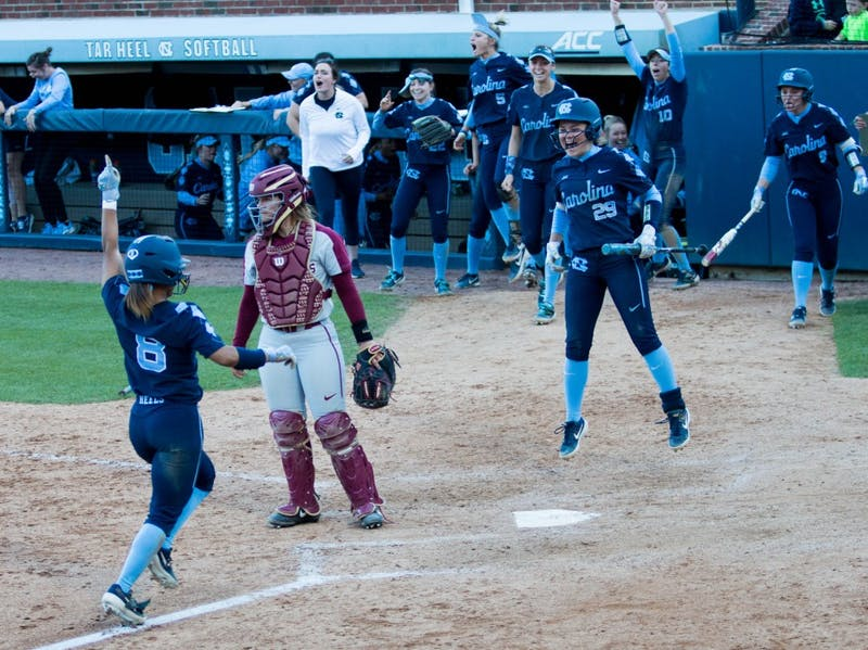 UNC senior outfielder Kiani Ramsey (8) rounds first base after a home run by UNC freshman infielder Abby Settlemyre (29) during a double header against the FSU Seminoles at Eugene G. Anderson Softball Stadium on Monday, April 15, 2019. The Tar Heels beat the Seminoles in both games.