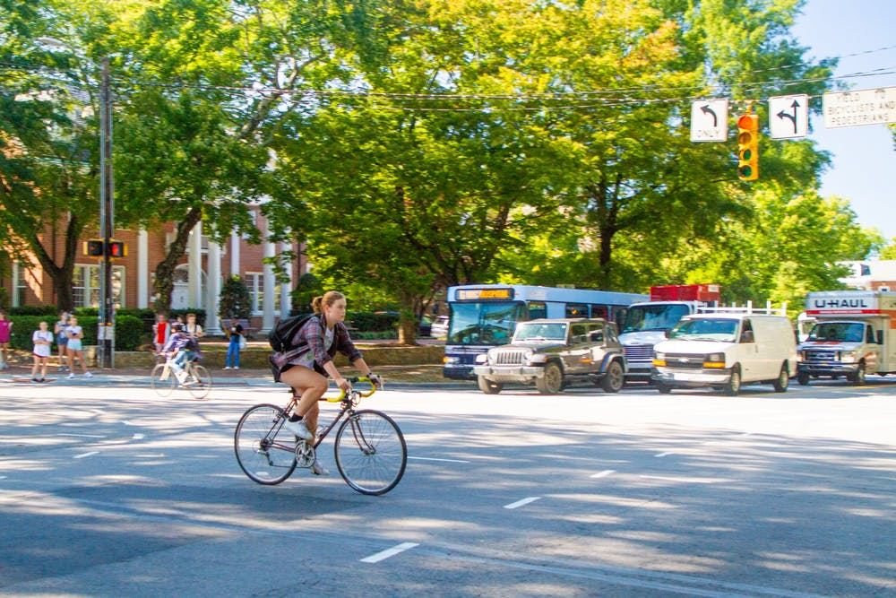 A cyclist heads toward the UNC-CH campus at the intersection of Cameron Ave. and S. Columbia St. on the afternoon of Sept. 27th.