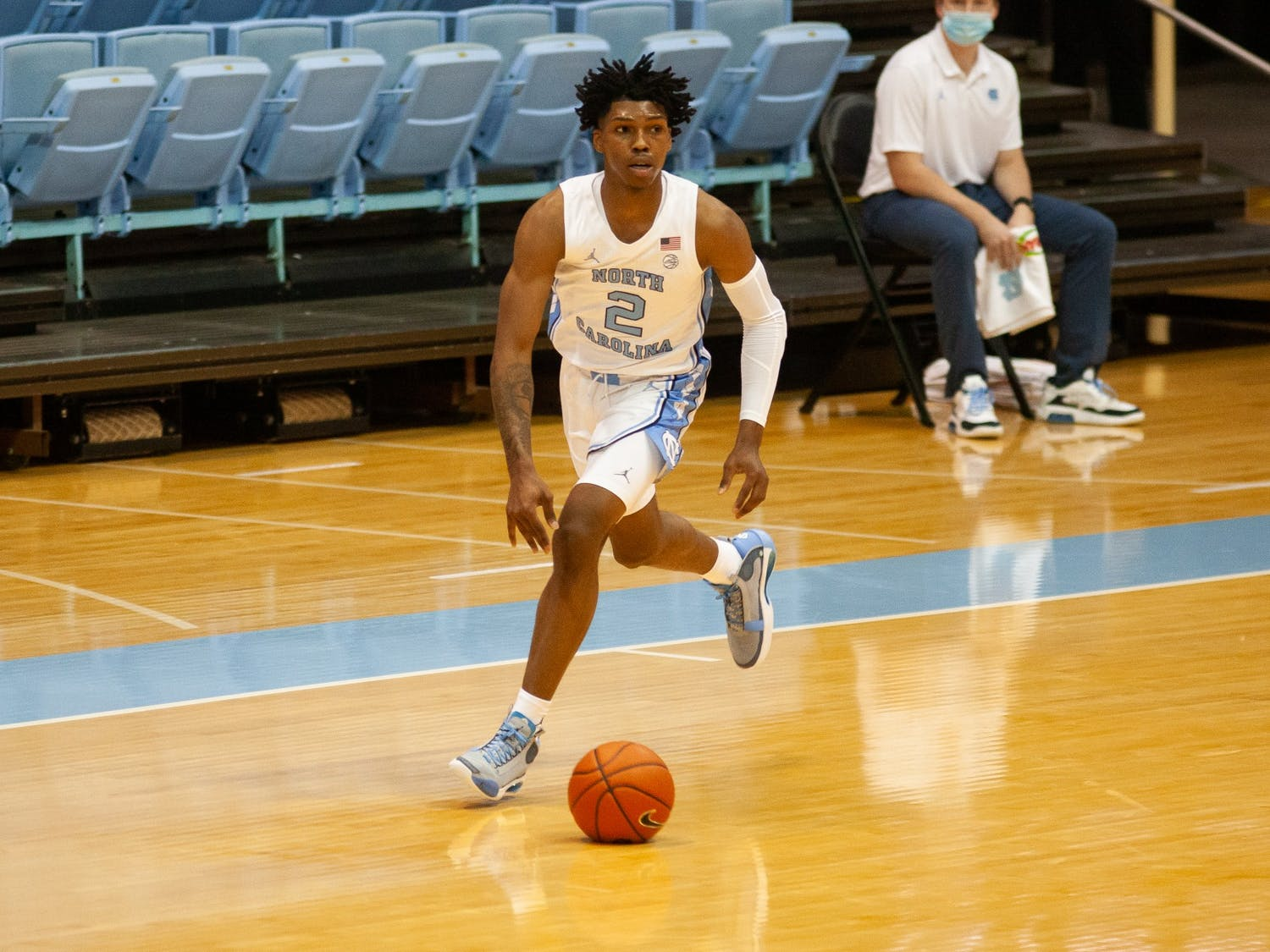 First-year guard Caleb Love (2) drives the ball in the game against the College of Charleston on Wednesday, Nov. 25, 2020.