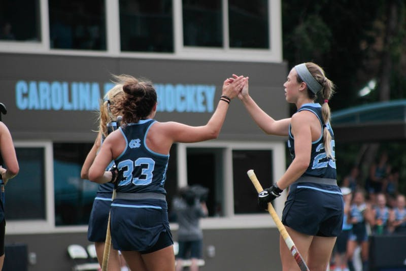 Forward Marissa Creatore (33) high-fives midfielder/forward Megan Duvernois (29) on Sunday Sept. 15, 2019. UNC's field hockey team won 8-0 against William and Mary.