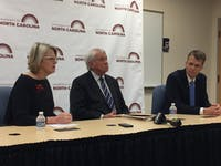 Spellings, BOG Chairperson Lou Bissette and UNC-system general counsel Thomas Shanahan speak to reporters in a press conference.