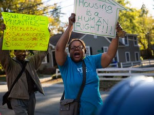 """(From left) Ronald Carnes, 74, of Chapel Hill, and Chinita Howard, CEF orientation coordinator, march down the street from Chapel Hill Town Hall during a rally organized by the Community Empowerment Fund calling for affordable housing for people in poverty below 30% AMI on Friday, Nov. 1, 2019. """"Until we keep getting in the face of our politicians, this problem is going to continue,"""" Carnes said. """"Something needs to be done to get this thing moving properly, and they need to take off some of those barriers where they're keeping people who need housing."""""""