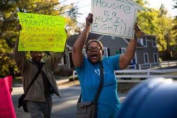 "(From left) Ronald Carnes, 74, of Chapel Hill, and Chinita Howard, CEF orientation coordinator, march down the street from Chapel Hill Town Hall during a rally organized by the Community Empowerment Fund calling for affordable housing for people in poverty below 30% AMI on Friday, Nov. 1, 2019. ""Until we keep getting in the face of our politicians, this problem is going to continue,"" Carnes said. ""Something needs to be done to get this thing moving properly, and they need to take off some of those barriers where they're keeping people who need housing."""
