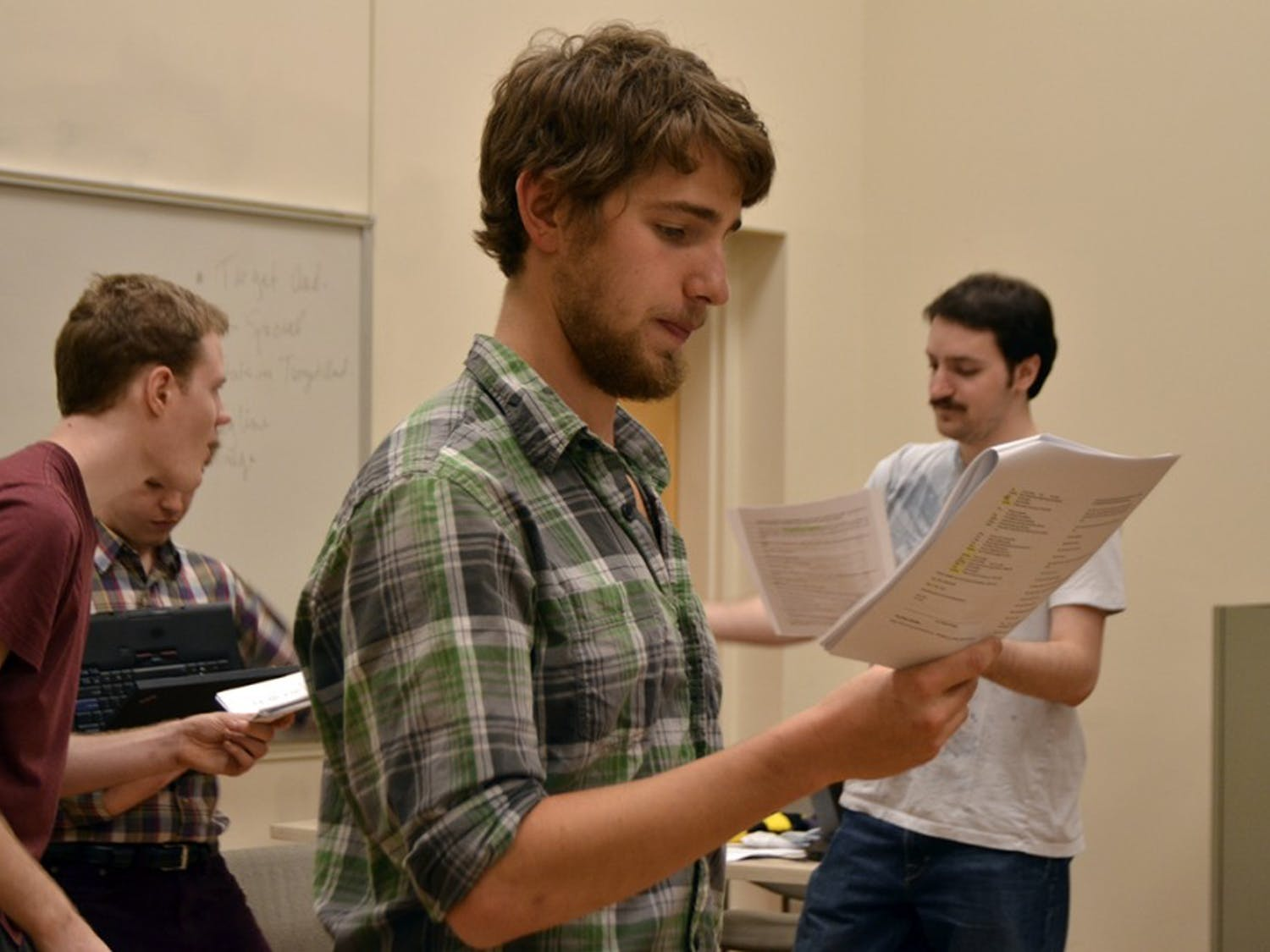 """Brandon Rafalson, Anthony Kilburn and Ethan Carleton, actors of """"Arr! Eh?"""", rehearse a song for the upcoming performance on Sunday. As the performance is a staged reading, """"it is mostly to give everyone a sense of the songs and dialogue,"""" said Cameron Yow, the director of the student written work."""