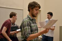 "Brandon Rafalson, Anthony Kilburn and Ethan Carleton, actors of ""Arr! Eh?"", rehearse a song for the upcoming performance on Sunday. As the performance is a staged reading, ""it is mostly to give everyone a sense of the songs and dialogue,"" said Cameron Yow, the director of the student written work."