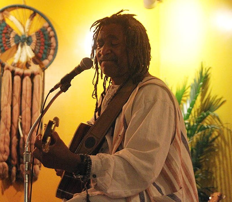 Gregory Blaine plays reggae jazz and blues at Oasis coffee shop almost every weekend as a popular local musician.