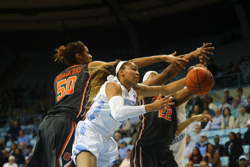 First year guard Stephanie Watts (5) reaches for the ball during a game against Syracuse.