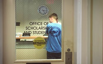 A peer counselor at the Office of Scholarships and Student Aid gives financial advice to an incoming transfer student. Students with work study jobs are eligible for SNAP benefits, but few UNC students use the program.