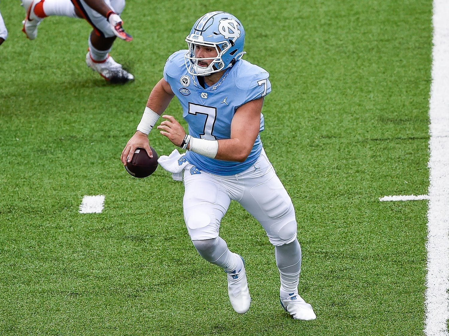 UNC sophomore quarterback Sam Howell (7) prepares to run the ball during a game against Syracuse in Kenan Memorial Stadium on Sept. 12, 2020. UNC beat Syracuse 31-6.
